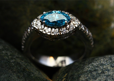 Custom Diamond and Blue Topaz Halo Ring in White Gold